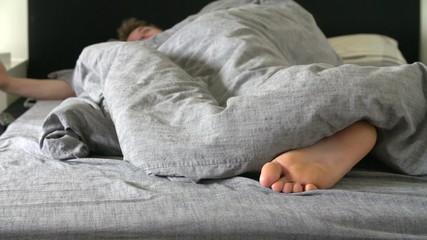 Teenage Boy Asleep In Bed