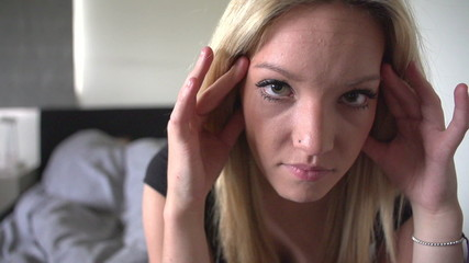 Slow Motion Sequence Of Unhappy Teenage Girl In Bedroom