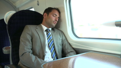 Businessman Resting On Train Journey