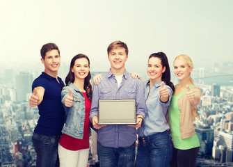 smiling students with laptop computer