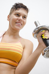 Young girl lifting weights smiling
