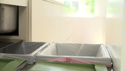 Slow Motion Sequence Of Man Recycling Kitchen Waste In Bin
