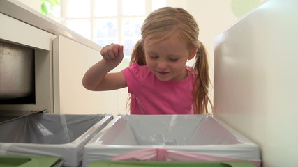 Slow Motion Sequence Of Girl Recycling Kitchen Waste In Bin