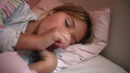 Young Girl Asleep In Bed Sucking Thumb
