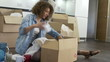 Woman Packing Boxes Ready For House Move