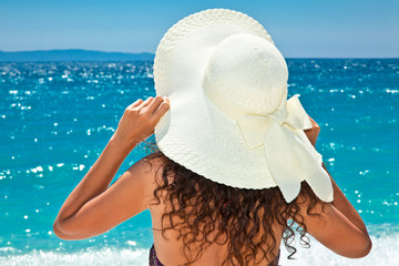 Beautiful woman in sunhat looking view of beach
