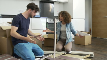 Frustrated Couple Putting Together Self Assembly Furniture