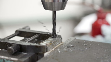 Slow Motion Sequence Of Drilling Metal Block