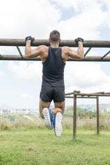Athletic muscular man pushup, outdoor.