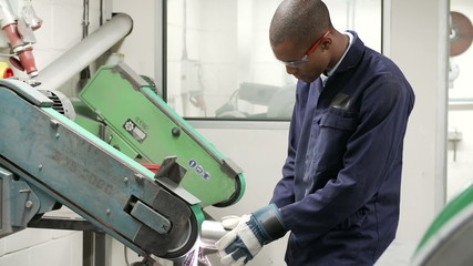 Engineer Using Grinding Machine In Factory