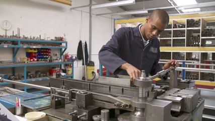 Time Lapse Sequence Of Factory Engineer Operating Equipment