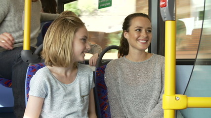 Two Young Women On Bus Journey Together