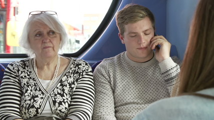 Man Disturbing Passengers On Bus Journey With Phone Call