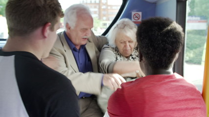 Senior Couple Being Harassed On Bus Journey