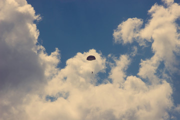 vintage Silhouette of skydiver at blue sky