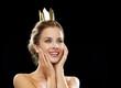 laughing woman wearing golden crown