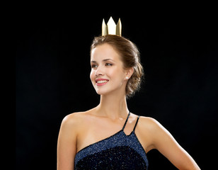smiling woman in evening dress wearing crown
