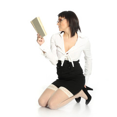 erotic woman  in white stockings reads a book
