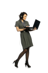 An attractive girl talking on the internet with headphones