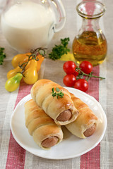 Hot-dog with sausages in a plate