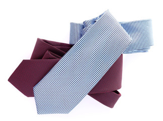 Brown and blue ties on white background isolated