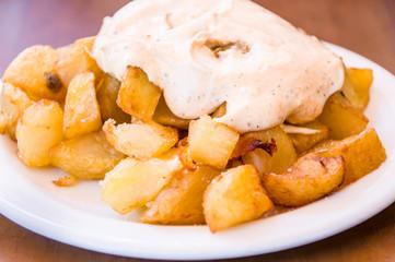 typical spanish patatas bravas, spicy potatoes