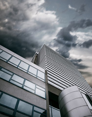 Modern office center building with apocalyptic sky