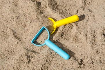 Toys in a sandbox closeup