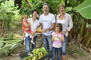 farmer and customer family in banana plantation