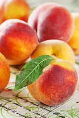 fresh peaches on a wooden table .