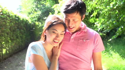 Romantic Asian Couple On Walk In Countryside