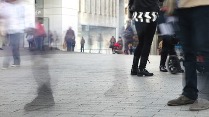 Time Lapse Sequence Of Shopper's Feet On Busy Street