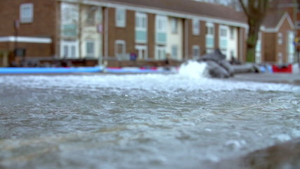 Slow Motion Sequence Of Pumping Water From Flooded Road