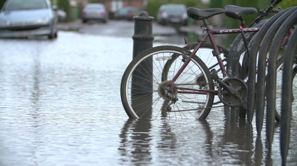 Slow Motion Sequence Of Cycle Rack On Flooded Road