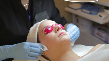 Woman Having Dermo Abrasion Cosmetic Treatment At Spa