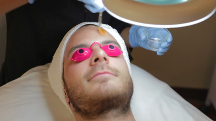 Man Having Dermo Abrasion Cosmetic Treatment At Spa