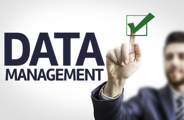 Business man pointing the text: Data Management