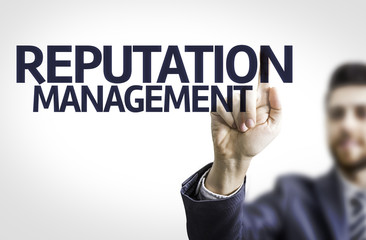 Business man pointing the text: Reputation Management