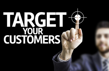 Business man pointing the text: Target Your Customers