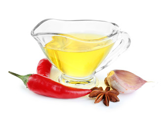 Homemade natural infused olive oil in glass sauce-boat with red