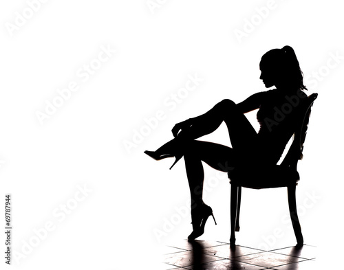 silhouette of pretty stripper on a chair © vladimirfloyd