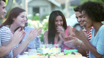 Group Of Friends Celebrating Birthday Outdoors Together