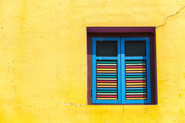 Colorful windows and details on a colonial house in Little India