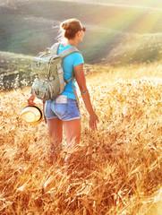 Woman in golden wheat field
