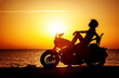 Woman biker enjoying sunset