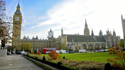 Traffic near Westminster square Big Ben and House of Parliament