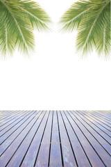 Green coconut leaves over wooden floor