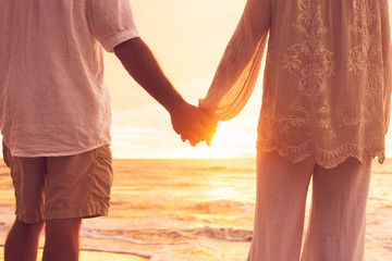 Senior Couple Holding Hands Enjoying at Sunset