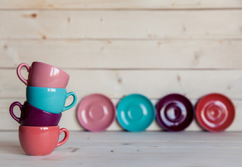 Bright dishes on table on a wooden background