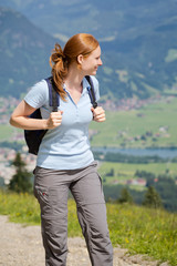 Woman on a Mountain Trail in Summer